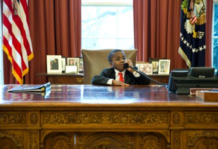 "April 1, 2013 ""Robby Novak, AKA 'Kid President', feigns a phone call at the Resolute Desk during his visit to see the President in the Oval Office. 'Kid President' became a YouTube sensation and was invited to participate in the Easter Egg Roll at the White House.""  (Official White House Photo by Pete Souza)  This official White House photograph is being made available only for publication by news organizations and/or for personal use printing by the subject(s) of the photograph. The photograph may not be manipulated in any way and may not be used in commercial or political materials, advertisements, emails, products, promotions that in any way suggests approval or endorsement of the President, the First Family, or the White House."